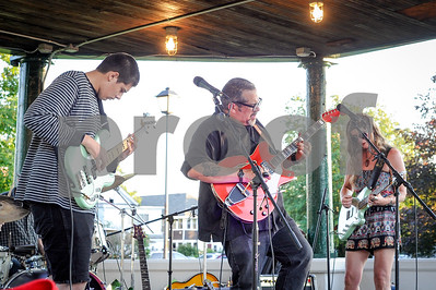 Robert Layman / Staff Photo Rick Reddington & The Luv perform at Main Street Park in Rutland July 5, 2017. Rick, center, invited his son Ben, left,  on stage to celebrate his birthday, which he did with a funky bass solo.