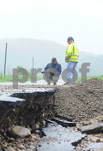 Robert Layman / Staff Photo Keith McGinnis, left, with FEMA, conducts a damage assessment with Daryl Burlett, Brandon Public Works Director at the end of the half mile section of the Newton Road flood site Thursday morning, July 13.