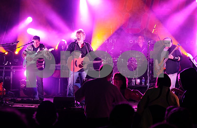 """Robert Layman / Staff Photo  8084 performs """"When Angels Slip Away"""" during the Friday Night Live concert. The song was written for a long time supporter and friend of the band, Jennifer McClintock, who passed away in 2016 from pancreatic cancer."""