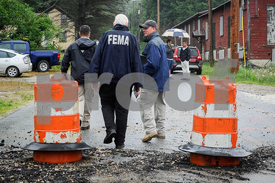 Robert Layman / Staff Photo Members of the FEMA damage asessment team survey the site on Newton Road in Brandon, July 13, 2017.
