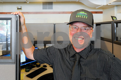 Robert Layman / Staff Photo Lyle Jepson, Executive Director of REDC, poses with a Killington Valley ball cap at the REDC office.