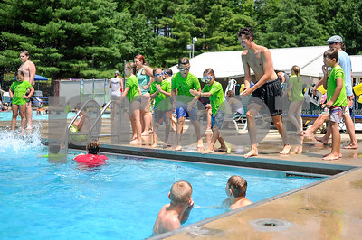 Robert Layman / Staff Photo Tapestry counselor Avery Provin, second from right, goes over some diving posture with a group of kids at Northwood Pool in Rutland Town Friday afternoon. Temperatures rose into the mid eighties bringing large crowds to the pool.