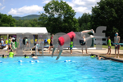 Robert Layman / Staff Photo Tyler Mitchell of the Rutland County Boys & Girls Club dives into the Northwood Pool Friday afternoon. Sunshine and temps in the mid-80's brought more than 100 people to the pool to kick off the weekend.