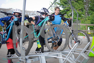 Robert Layman / Staff Photo Riders load up their bikes on the Snowshed lift racks.
