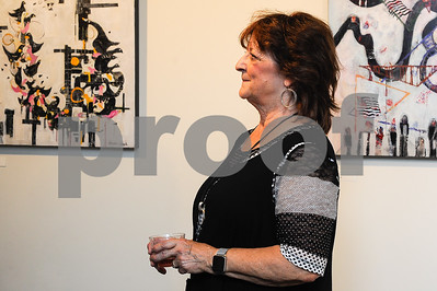 Robert Layman / Staff Photo Mary Fran Lloyd talking with Peter Huntoon at Lloyd's gallery reception Friday night.