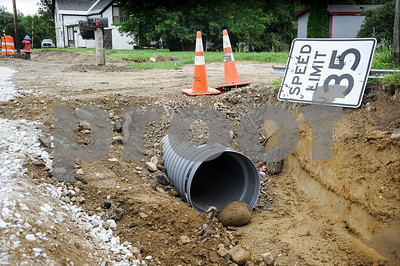 Robert Layman / Staff Photo Residents on Newton Road now have larger culverts under their driveway -- expanded from 8 inches all the way to 18.