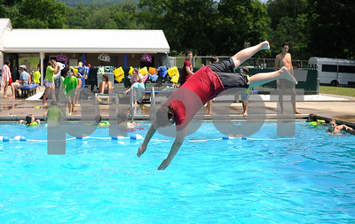 Robert Layman / Staff Photo With Vermont's long winters, kids during the summer need to take every advantage of outdoor time they can, and being in The Boys & Girls Club can help do that. Seen here Tyler Mitchell dives into the Northwood pool last Friday during one of their visits, which they try to make three a week.
