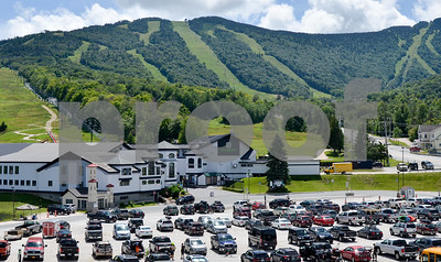 Robert Layman / Staff Photo The parking lot at Killington Resort's Snowshed lodge is seen filled with traffic during their summer season.