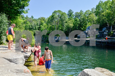 Robert Layman / Staff Photo Kids reluctantly leave the quarry as the call for lunch is made.