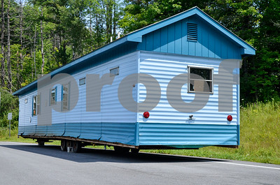 Robert Layman / Staff Photo This blue mobile home is seen parked alongside Route 7 north's parking pull off before the 103 intersection.