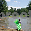 Robert Layman / Staff Photo A pair of boys walk with their floatation devices alongside the shores of Lake St. Catherine State Park July 2, 2017.