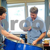 Robert Layman / Staff Photo Cohen, left, shows participants where and how to hit a steel drum.