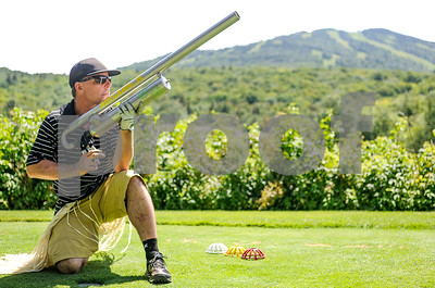 Robert Layman / Staff Photo Shaun Cattanach waits for the wind to die down before he takes hsi shot with the AIRCANNON -- an  oxygen powered device that can propel a golf ball over 250 yards against the wind.
