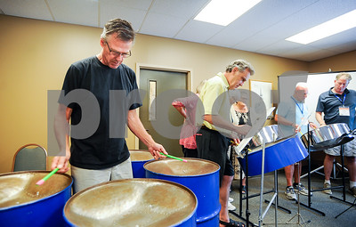 "Robert Layman / Staff Photo John Davis, left, participates in the steel drumming workshop with other members of the Twin Rivers Supervisory Union during their team building exercise with Cohen's class. Davis is assistant principal at Ludlow Elementary School and Black River High School. When asked about his experience during the class he said ""It's a challenge. It reminds you how difficult it is to be a learner."""