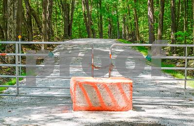 Robert Layman / Staff Photo A barrier blocks passage on Old Hubbardton Road.