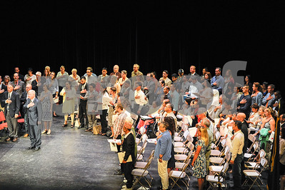 Robert Layman / Staff Photo Seventy-two new citizens recite the Pledge of Allegiance at the end of their naturalization ceremony Tuesday in the Paramount Theatre.