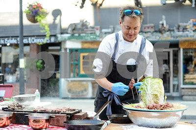 Robert Layman / Staff Photo Jason Tostrup, Executive Chef at Okemo Mountain Resort, prepares wagyu beef kebabs during the 36th annual Winter in August Tuesday night on Merchants Row in Downtown Rutland.