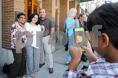 Robert Layman / Staff PhotoDenisa Macias, center left, stands with her mother Margarita, left, and brother Juan Pile, as her