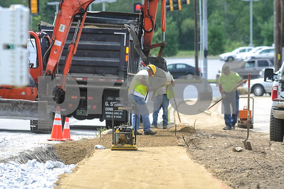 Robert Layman / Staff Photo Construction is underway on the sidewalk along the Route 7 side of Cold River Road in Rutland Town Tuesday.