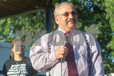 "Robert Layman / Staff Photo Former Rabbi Doug Weber, right, who announced his retirement from the Rutland Jewish Center  at the beginning of August, speaks during the NAACP-led rally at Main Street Park Monday, August 14, 2017, which was held to show support for the victims of violence in Charlottesville, VA. Rabbi opened his remarks with saying ""You can't retire from standing up to hate."""