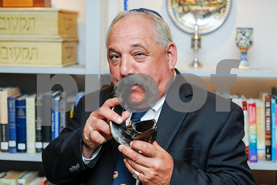 Robert Layman / Staff Photo Rabbi Doug Weber blows the shofar horn at the Rutland Jewish Center Tuesday morning, August 15, 2017, The horn, which is from a ram, is used on the Jewish holdiays Rosh Hashanah and on the end of Yom Kippur.