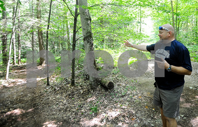 Robert Layman / Staff Photo Michael Rowe, Recreation Director for Rutland Town, points down a trail that he and town volunteers cut to expand trails at Northwood Park.