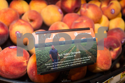 Robert Layman / Staff Photo Seen here is a sign that identifies produce Sun Valley Orchards from Swedesboro, NJ, a 3,000 acre farm that's been conserved under a Farmland Preservation Deed.
