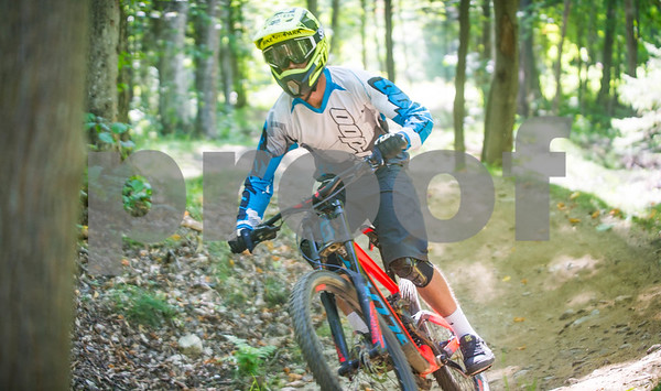 Robert Layman / Staff Photo A competitor gets some air near the final stretch of the Sideshow Bob trail during the final race of the Killington Mountain Biking Club Bike Bum series Wednesday afternoon.