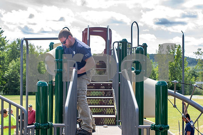 Robert Layman / Staff Photo  Jim Baldwin, a GE volunteer, secures handrails on the new playground at the Barstow Memorial School in Chittenden, Friday September 2, 2017. Baldwin also served on the playground comittee that helped bring this project to life.