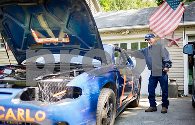 Robert Layman / Staff Photo Chuck Wanner, of Chittenden, checks over his 2003  Chevrolet Monte Carlo in his driveway Friday afternoon, September 1, 2017. Wanner's skills as a career mechanic allowed him to turn a $150 car into a competitor for a race this  Saturday, September 2, at Bear Ridge Speedway in Bradford, Vermont.