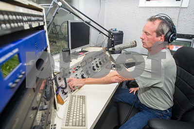 Robert Layman / Staff Photo Broadcaster Greg McCormack preparing to give his noon news update on the 94.1 FM side at the station in Poultney Tuesday September 5, 2017.