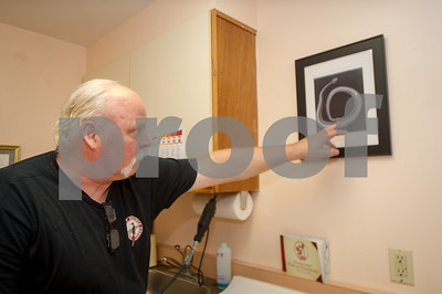 Robert Layman / Staff Photo Scott MacLachlan points to an x-ray of a northern timber rattlesnake in one of the exam rooms. The x-ray was taken after MacLachlan embedded a tracking device into the snake in 2014 as part of an ongoing study with biologist Doug Blochett of the Nature Conservancy Center who was studying their habits.