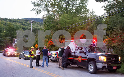 "Robert Layman / Staff Photo  A rescue crew from Ira and West Rutland fire departments, along with Vermont Sate Police and Rutland Regional Medical Center, line Whipple Hollow Road at the entrance to a logging road in West Rutland Tuesday night after a para glider incident was reported. Tim Perry, Cheif of Ira Fire Department, said a call was reported at 6:29 p.m. to him about a hang glider crashing at the foot of Hanley Mountain, which has a summit where para gliders jump off from. The incident was reported after a farmer unhooking his hay wagon happened to spot the hang glider go down. Perry said two other hang gliders were flying at the same time and were able to land and assist the downed pilot. When asked about the condition of the pilot involved in the crash, Perry said ""He is able to walk around."" By using a utility task vehicle, the rescue crew was able to reach the pilot at 7:12pm. No other information was available."