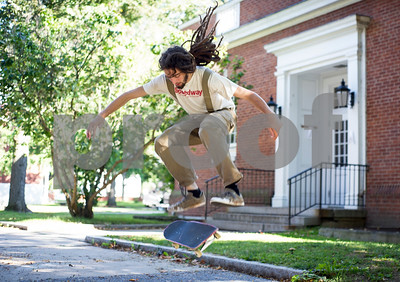 "Robert Layman / Staff Photo  Green Mountain College Senior Owen Zecca performs a kick flip on campus Tuesday afternoon after classes. Zecca, originally from New Jersey, came to GMC because of the sustainable agriculture program and hopes to work in the mycoremediation industry after school. ""Green Mountain College is a unique place,"" he said."