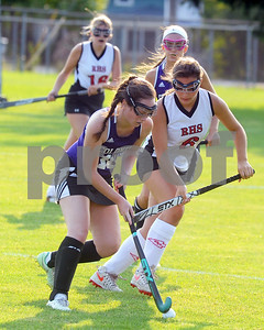 Robert Layman / Staff Photo  Brattleboro's Abby Wimer, left, tries to move past the defense of Rutland's Francie Ettori, right, during the varsity girl's field hockey match Monday night on Alumni Field. Ettori scored the only goal of the night, giving the Raiders' a 1-0 win over the Colonels.