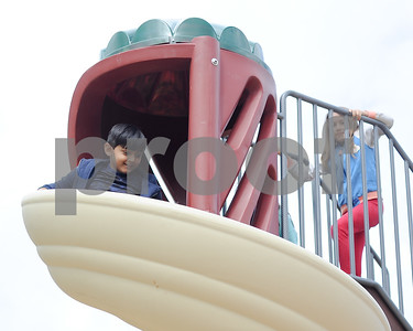 A child smiles as he decends the new slide at Barstow Memorial School Friday afternoon.