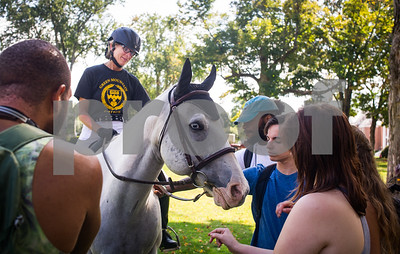 Robert Layman / Staff Photo Green Mountain College Professor of Philosophy and euqestrian enthusiast Heather Keith shows off her horse Mystic to a group of students following a dressage performance with professional rider Stephanie Wissell on campus Friday afternoon. The college recently announced their new minor in equestrian studies, which Kieth is director of.