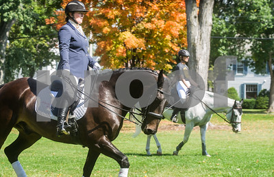 Robert Layman / Staff Photo Stephanie Wissell, left, warms up her horse R.U. Sirius before putting on a dressage and freestyle performance with Green Mountain College Philosophy Professor Heather Kieth, right, and her horse Mystic, at campus Friday afternoon. GMC recently began an equestrian science minor which Kieth is the director of. Roughly over two dozen students attended the performance and asked questions afterwards.