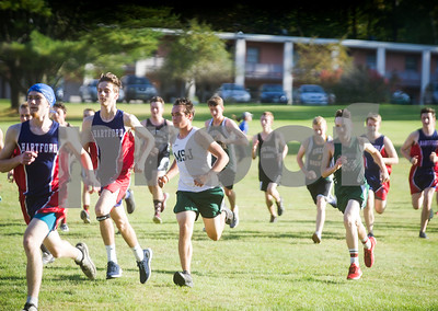 Robert Layman / Staff Photo  Boys from various high schools take off during the start of Tuesday's cross country meet at the College of St. Joseph.