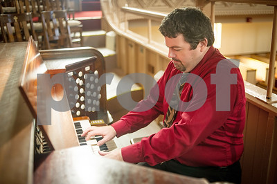 Robert Layman / Staff Photo Allister Stout plays the organ at Grace Congregrational Church Thursday morning. Allister, originally from Scotland, then Pittsburgh, PA, is calling Rutland home after accepting the position as the new Minister of Music.