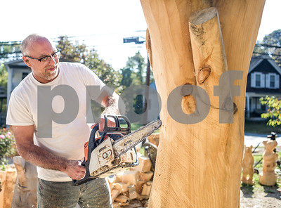 Robert Layman / Staff Photo  Pinske works on a tree that will be installed at a local store carrying his rough cuts. Pinske helps people who complete a rough cut carving from one of his templates will post pictures to the tree for others too see.