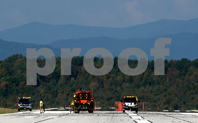 Robert Layman / Staff Photo  Heat on the runway at Rutland Southern Vermont Regional Airport created a mirage like effect, which is seen here as the maintence crew in the distance repaints lines Tuesday.