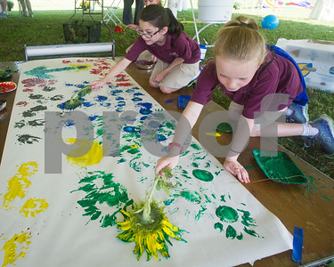 Robert Layman / Staff Photo Christ the King Students paint with sunflowers during the Come Alive Outside Event at the Rutland Regional Medical Center Wednesday afternoon, September 27, 2017.