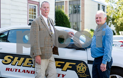 Robert Layman / Staff Photo Rutland County Sheriff Stephen Benard, left, poses with Geoff Thompson, of Rutland County, England.