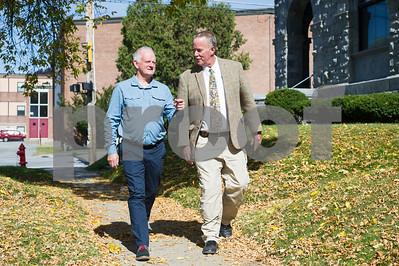 Robert Layman / Staff Photo Rutland County Sheriff Stephen Benard, left, walks down grove street with Geoff Thompson, of Rutland County, England Wednesday afternoon, October 4, 2017.