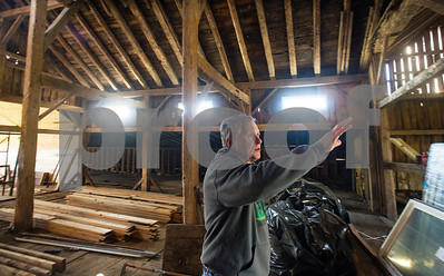 Robert Layman / Staff Photo  Standing in an old 19th century barn, Rob Proctor explains some of the ongoing renovation projects he and his business partner Bob Stannard are undertaking after recently being awarded money from the Vermont Conservation Loan  Fund to fix. Proctor says he hopes to host wedding and other large-group events with his new business venture in agricultural tourism.