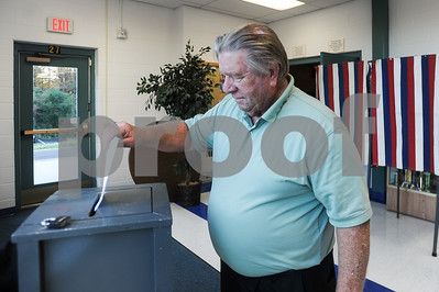 Robert Layman / Staff Photo Jim Mahoney casts a ballot during Act 49 voting at Rutland Town School Tuesday night.