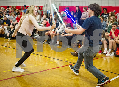 Robert Layman / Staff Photo  A pair duels in front of the crowd at Ryan Farrington's Make A Wish Reveal ceremony in the Rutland High School gymnasium Tuesday, October 10, 2017.
