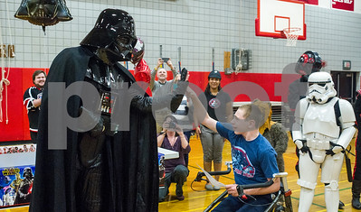 Robert Layman / Staff Photo Ryan Farrington, right, meets Darth Vader, which here is enacted by Eric Brager of The 501st New England Garrison -- a group dedicated to role playing Star Wars Characters -- at Farrington's Make A Wish reveal at the Rutland High School Gymnasium Tuesday.