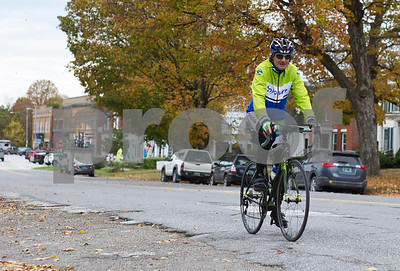 Robert Layman / Staff Photo  Wayne Lawrence, a cyclist tour guide from Middlebury rides along Park Street in Brandon as he catches up with his group on their way to Lake Dunmore Wednesday, October 11, 2017.